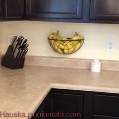 Hanging planter basket re-purposed as a fruit holder! Frees up valuable counter space. Neat idea