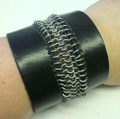 Leather bracelet with chain maille in the middle. Titanium rings.