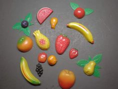 Fruit fridge magnets. My grandmother had these.  Might have been slightly different...