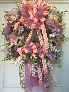 Coral and Purple Spring and Summer Mesh Wreath by WilliamsFloral on Etsy https://www.etsy.com/listing/228389727/coral-and-purple-spring-and-summer-mesh