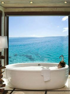Bathtub with a view of the ocean and a million stars...