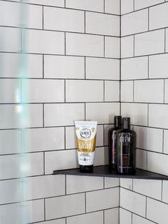 Corner shower shelf with tile. Timeless Black and White Master Bathroom Makeover Tile Shower Shelf, Shower Corner Shelf, Bathtub Shelf, White Tile Shower, Bathtub Tile, Black Shower, Bathtub Shower, Bathroom Showers, Shelves In Shower