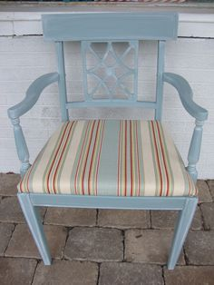 This arm chair was painted in the same blue gray and then glazed in offwhite. The seat was recovered in a complimentary striped fabric.