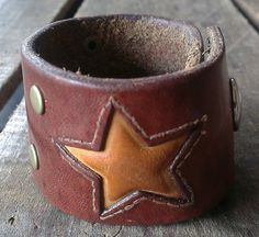 Hey, I found this really awesome Etsy listing at https://www.etsy.com/listing/184648758/brown-leather-star-cuff-vintage-belt