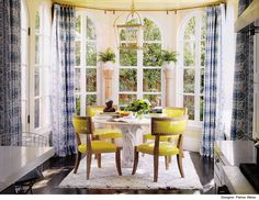 love this combo and the exotic quadrille fabric panels. those are indestructible valtekz chairs too.