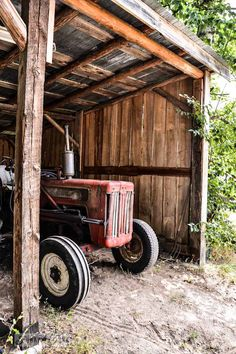 Old red tractor in a rustic wood shed - Part 6 / Dreamy Cottage Grounds via Funky Junk Interiors
