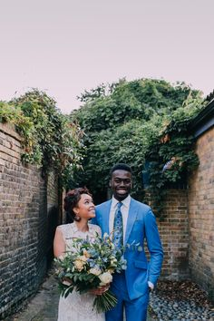 Modern, romantic couple shot   Styling by Nulyweds, Photo by Anne Schwarz, Dress by Claire Pettibone at Blackburn Bridal, Suit by Kwame Koranteng, Venue The London Rowing Club