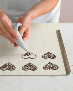 little piped chocolate heart decorations - from Martha Stewart