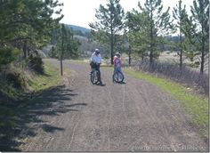 Two people stop to get a drink of water on the scenic Mickelson Trail in the Black Hills of South Dakota.  It stretches 109 miles from Deadwood to Edgemont. @Patricia Nickens Derryberry Rapid City