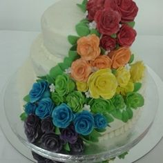 Rainbow Wedding Cake made for the Reverend Janie Spahr and several beautiful couples.  All roses are made from fondant and gumpaste mixture.  Made by Bless Her Heart Cakes, San Antonio, Texas