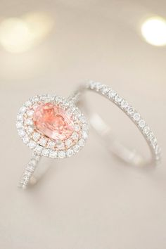 This stunning double-halo engagement ring sparkles brilliantly with 77 round diamonds set in a quality 14k white and rose gold pavé setting. A lovely 1.00-carat oval peach sapphire center stone makes this ring elegant and unique.