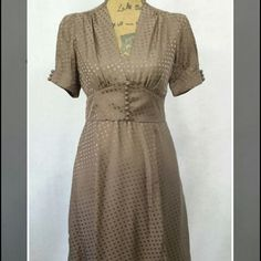 "BANANA REPUBLIC || SILK A-LINE DRESS * This beauty has such a retro vintage look to it! * Color: Mocha * Tone on tone polka dot pattern * V-neck w/decorative buttons in front and sleeves * Hidden side zipper * 100% Silk  * Fitted waist gives a gorgeous silhouette  * Length - 36"" * Excellent condition! (Just a little wrinkled from storage!) * Feel free to ask for measurements   This item will be cross listed! Reasonable offers always considered. Over 170 items listed so take a look and bundle…"