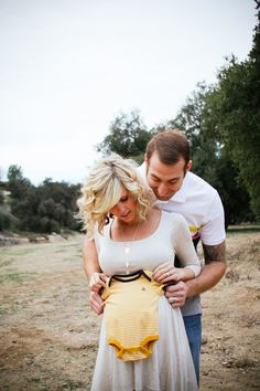 Fun maternity shoot! I want my hair curled like hers lol