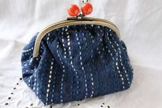 Simple sashiko on a little purse by Michiko Oba of Fukuoka, Japan. Her trademark…