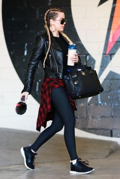 Khloe Kardashian wearing Hermes 35cm Birkin Bag in Black, Fendi Karlito Fox Fur Two Tone Bag Charm, Balenciaga Leather Jacket and Apl Athletic Propulsion Ascend Sneakers
