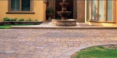 Paving stones enhance the beauty of driveway.