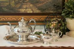 The tea service is by Sheridan Silver Co. Inc.  I'd date the set to the late 1940's.