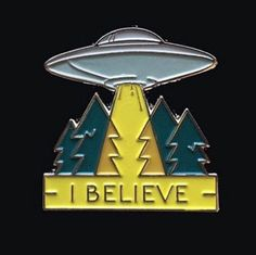 """Do you believe in UFOs? Aliens? The Supernatural? Now you can tell everyone with this awesome soft enamel UFO Pin that says """"I BELIEVE"""" Approx 1"""" tall Metal back with Rubber Clasp One post Like our st"""