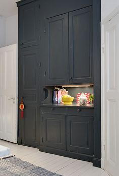 These builtin cabinets look so great painted in contrast to the rest of the trim work