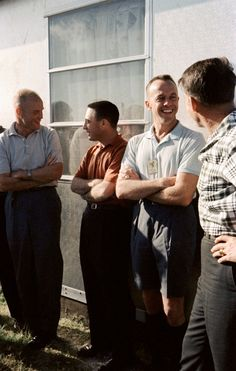 John Glenn, Gus Grissom, John Shepherd, and Wally Schirra stand together during a photo shoot during Project Mercury Training in 1962.