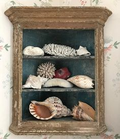 Antique cabinet styled with shells