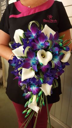 Beautiful bridal bouquet of Calla Lilies and Singapore Orchids. Stunning colours!