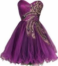 Purple Strapless with a gold and black feathering across the bust and the waist~ ruffles along the bottom