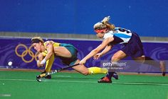 Renita Garard of Australia is challenged by Vanina Oneto of Argentina in the Womens Hockey Final at the State Hockey Centre on Day 14 of the Sydney 2000 Olympic Games in Sydney, Australia. \ Mandatory Credit: Darren McNamara /Allsport