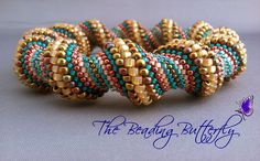 Harvest Cellini Spiral Bangle by ~beadg1rl on deviantART bronze iris beads in 15/o and 8/o, teal delicas and 11/o beads, coral delicas, permanent finish metallic wine, and silver lined light brown for the outer 8/o beads