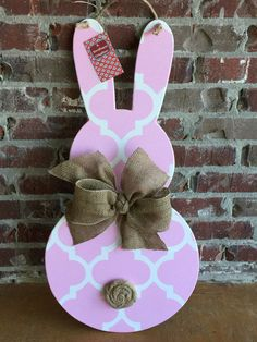 Greet your guest with this adorable Wood Easter Bunny Door Hanger! My door hangers are all hand drawn, cut, sanded, and painted. I then apply a glitter wash to add some sparkle and seal it to protect from the weather. A burlap bow adorns the neck with a hand made burlap flower for the tail. Jute rope is used as the hanger! All my items are hand made and may vary slightly from picture. Approx. measurements are 14 wide x 29 tall. Dont like the colors... Contact me and request a custom design…