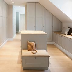 pale chalky grey and pale wood dressing room