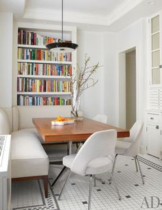 Cozy winter white dining nook. Design by Gomez Associates. Photo by William Abranowicz.