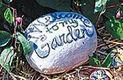 garden stones, whenever someone shares their flowers with me, I write their  name on a stone like this to remember them by and put it next to the flower.