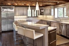 An Adorable Contemporary Log Manor Based On Manor In Colorado : Modern Log Cabin Kitchen Contemporary Design Small Bar Serving Counter Metalic Kitchen Theme Metalic Kitchen Counter Metalic Kitchen Garbage