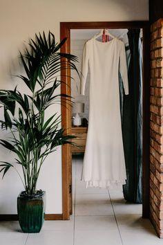 sophisticated + sleek long-sleeved wedding dress  Image by Zoe Morley