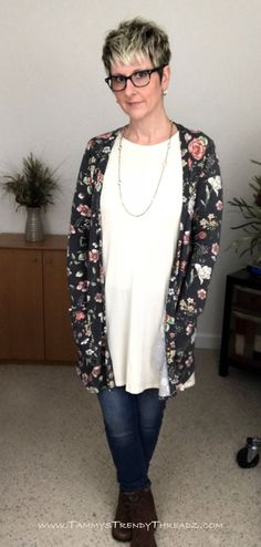 This black floral Essential Cardigan from Agnes & Dora is the perfect layering piece for adding warmth and comfort to any outfit.  The beautiful colors agains the dark charcoal gray background is so beautiful and versatile.  I have paired it with a cream Swing Tunic, but there are so many other colors that would also look great under it.  The cardi had buttons and pockets and has a super soft brushed cotton feel.  You can find both of these in my online Boutique while they last!!