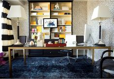 Meredith Heron's office with Thibaut's Tanzania Animal Spots wallpaper (black and white), well-styled bookshelves with yellow National Geographic magazines, brass desk, striped curtains, blue carpet and accents