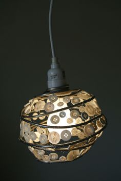 Globe button shade very interesting, not sure how its done. i'm guessing the metal orb, is strung with wire of fishing line, any ideas?