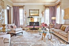 Glamorous #gold accents including a #Horn coffee table, #Colvara scones by Vaughan Designs, and a Murano mirror from L'Antiquaire | New York Cottages & Gardens | April 2014