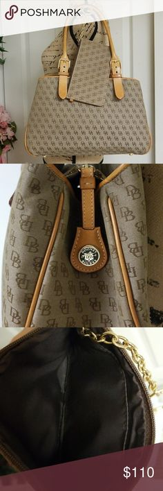 2 in 1 Dooney & Bourke Satchel and Wristlet. Very classy and stunning dark beige and light brown with tan straps Dooney and Bourke buckle satchel. Three compartments on the inside.   The middle compartment close witb zipper.   Two open pockets and one pocket with zipper in the middle compartment. Comes with key hanger. Comes with wristlet. Close with zipper. Contains two compartments.  Excellent condition Dooney & Bourke Bags Satchels