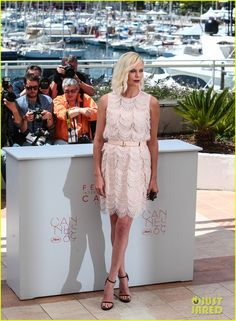 Charlize Theron & Ex Sean Penn Debut 'The Last Face' In Cannes, Respond to Negative Reviews: Photo #3661464. Charlize Theron strikes a pose in white while attending a photo call for her latest film The Last Face held during the 2016 Cannes Film Festival at the Palais des…