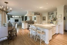 An open floor plan for this beautiful #kitchen. The calm white and cream tones are stunning.