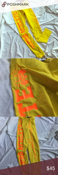 Labella Mafia Yellow Logo Leggings BNWT Labella Mafia leggings. Bright yellow with orange lettering. New ever worn tags still attached. Gorgeous color! Perfect condition. Pro Athlete on one leg Brand on other. Size small labella mafia  Pants Leggings