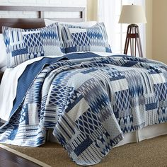 This lovely quilt offers a unique geometric design in blue and white. Coordinating shams complete the look.