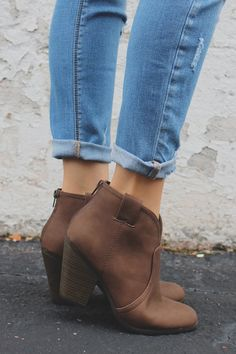 The ideal Fall bootie is here! Pair our Wild Horses Booties with your favorite distressed denim for a look that is sublime for any adventure. They are a pair of faux leather, western style ankle booti