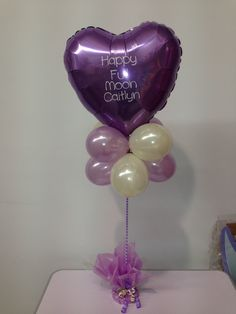 Personalised table decoration celebrating a full moon. Made by Let's Celebrate Parties.