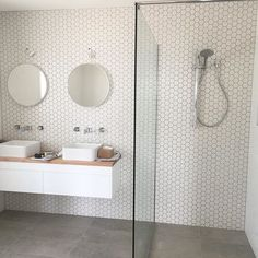 Simple, modern, minimalist bathroom with his and hers vanity Modern Scandinavian Bathroom ✖️White hexagon sheets and slate grey floor tiles ✖️ Best Bathroom Tiles, Bathroom Tile Designs, Wood Bathroom, Grey Bathrooms, White Bathroom, Bathroom Flooring, Bathroom Interior, Modern Bathroom, Small Bathroom