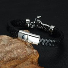 4c088ef37d2c The Motorcycle Black Braided Genuine Leather Bracelet is crafted of  stainless steel