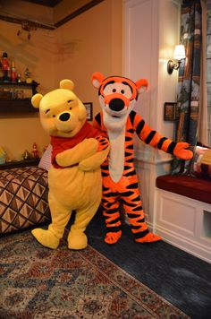 Winnie the Pooh and Tigger in Christopher Robin's bedroom.