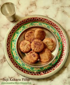 Suji Kakara Pitha is a traditional sweet dish from the Odia Cuisine. Basically, it is a deep fried semolina ball that is stuffed with sweet coconut filling. Suji Kakara pitha is crispy on the outside and sweet and juicy inside. It is so delicious, that it is included among the 56 bhogs that are offered to Lord Jagganath, of the Puri temple of Odhisha. You can serve suji kakara pitha as breakfast or snack or make it during festivals and special occasions as offering to deity.